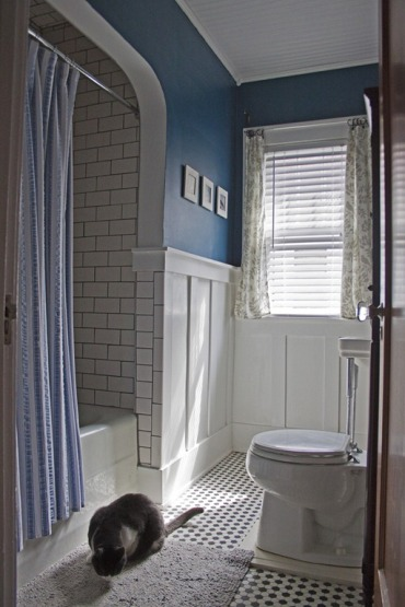 The addition of board and batten panels and a saturated blue (BM Blue Danube) added some snap to the bathroom.