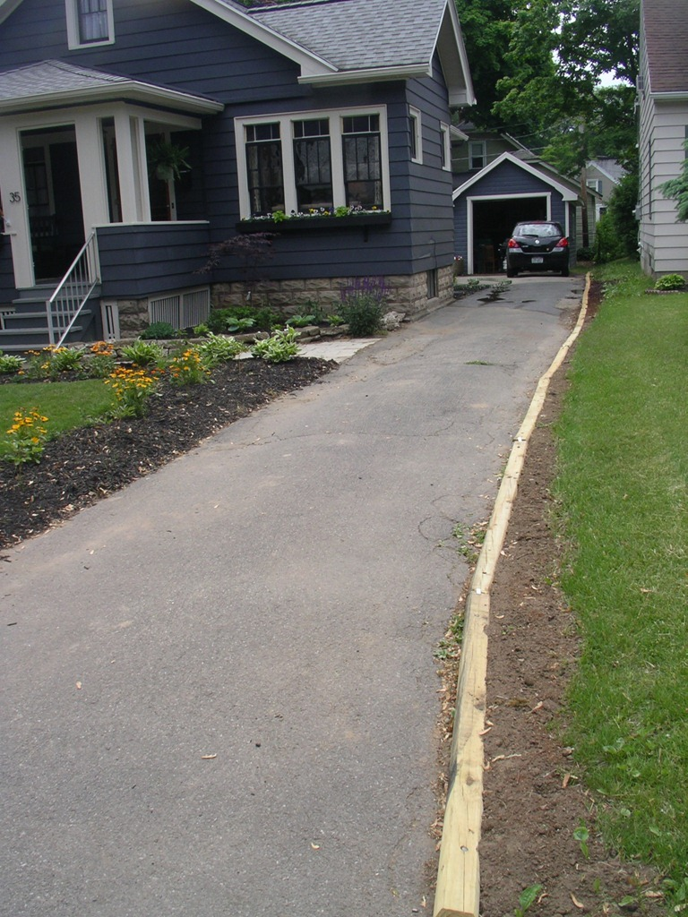 Ittybittybungalow updating and renovating a small for Edging to keep mulch off sidewalk