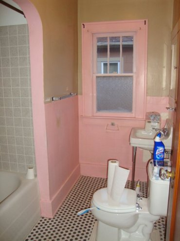 Bathroom Before: Pink trim and walls detracted from the orginal features like the hex tile floor.