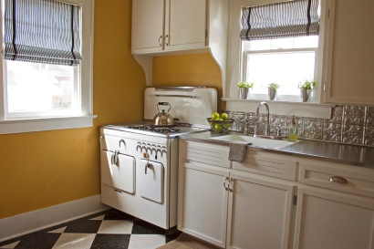 Kitchen After: A new floor, countertop paint and DIY roman shades helped bring the kitchn up-to-datw while still honoring its roots.